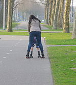 Mother teaches her child skating for mothers, this is also distractions and movement also good for digestion and to prevent constipation.JPG